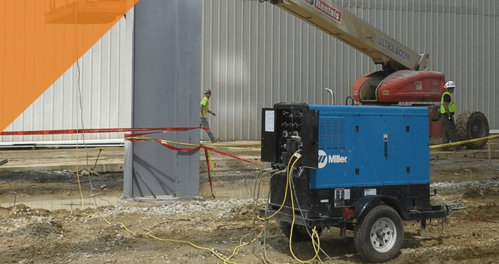 workers use a weld generator during a job